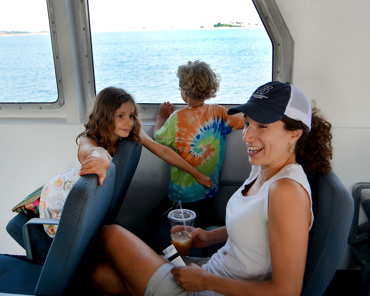 Lynn Ferry to Boston. Audrey Young and her two children Dermott (looking out the window) and Eliana. Swampscott.