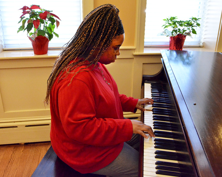 Lynn. Lynn Home for Women, Broad Street.  Erica Branch, Lynn, plays the piano in the dining room.