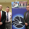 From left to right: Dennis Barton, DEA special agent, Tech grad 1978, Jim Ward, President of Tech Alumni, and Joe Nicholson, DEA special agent, and Lynn Classical grad 1980, worked a table at the job fair at Lynn Vocational Technical Institute today. Photo by Owen O'Rourke