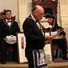 Worshipful Herbert H. French Fr., middle, reads the history of the Golden Fleece Lodge of Masons as Worshipful Master Richard R. Knowlton, right, and Most Worshipful  of Grand Masdter of Masons in Massachusetts, left, Harvey J. Waugh listen at the 150 anniversary jof the Golden Fleece Lodge in Lynn last night. Photo by Owen O'Rourke