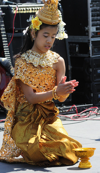 Aaliyah Sok was one of three youngsters to perform the Blessing Dance that opened the Cambodian New Year celebrations held on Lynn Common Saturday. Photo by Owen O'Rourke