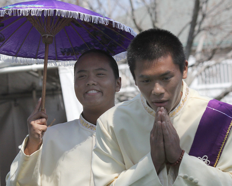 Piyet Chea, left, and Dillan Nguyan, right, rehearse back stage for their upcoming performance as groomsmen in a look at a Cambodian wedding at the Cambodian New Year Celebration on Lynn Common Saturday. Photo by Owen O'Rourke