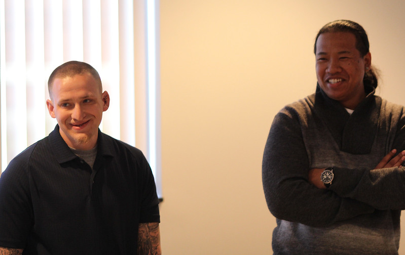 Justin Williams, left, former Cript gang member, currently a student at North Shore Community College and Jason Nop, former Blood gang member now on the staff at Straight Ahead, were speakers at the the Legislative Awareness Meeting held at the Lynn Police Station today. Photo by Owen O'Rourke