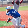 Lynn English's Joshue Perez (17) avoids the tag by Danvers' Corey Crossley (14) during their game at Fraser Field on Thursday, April 24. Item Photo / Angela Owens.