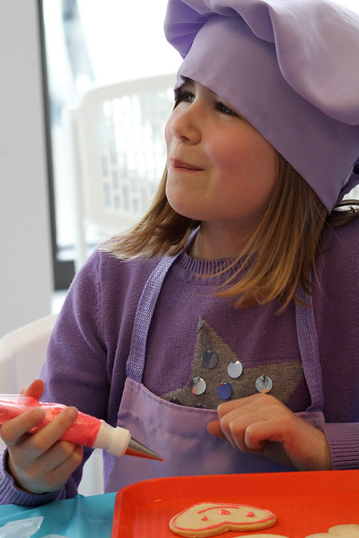 Lauren Ballou decorates one of her cookies at the cookie decorating class at Cygnet at 139 Lynnfield Street in Peabody today. Cygnet has classes in cake decorating, cup cake wars, birthday parties, and girl's night out during business hours everyday except Monday. Photo by Owen O'Rourke