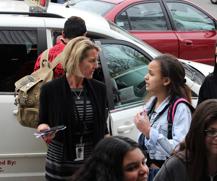 Marshall Middle School principal Molly Cohen, left, helps student Katherince Blasius, right, during dismissal at the end of day one at the new school. Photo by Owen O'Rourke
