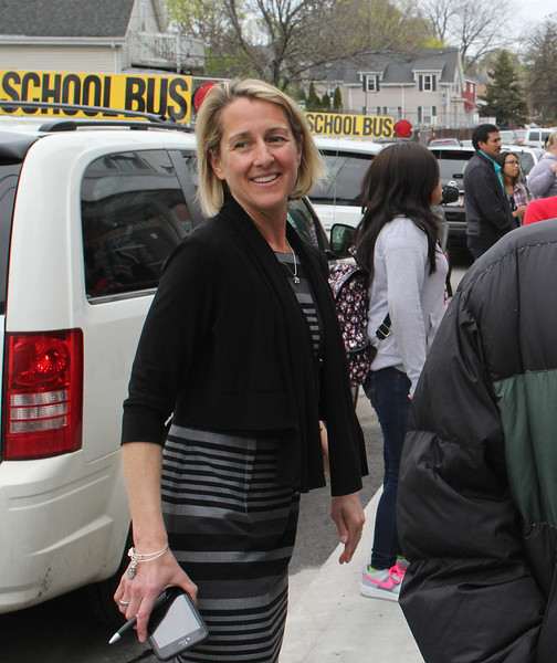 Marshall Middle School Principal Molly Cohen helping to direct early dismissal at the end of day at the new school. Photo by Owen O'Rourke