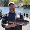 Brian Nickerson won this year's Fish and Game Protective Association Opening Day Derby held at Sluice Pond in Lynn Saturday by catching a 4 pound 11 once Rainbow Trout. Although he has fished for many years, this is the first time he has won. Photo by Owen O'Rourke