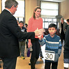 Lynn, City Hall.  Joel Abramson, Swampscott, gives a high five to Dario Gomez of the Robert L. Ford Elementary School, Lynn, as he heads downstairs to the stage. Sarah Palmer of Rockport Middle School is behind Dario.