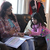 Sheila Nunes Costa, left, home schooling her daughter Nicole in Lynn. Photo by Owen O'Rourke