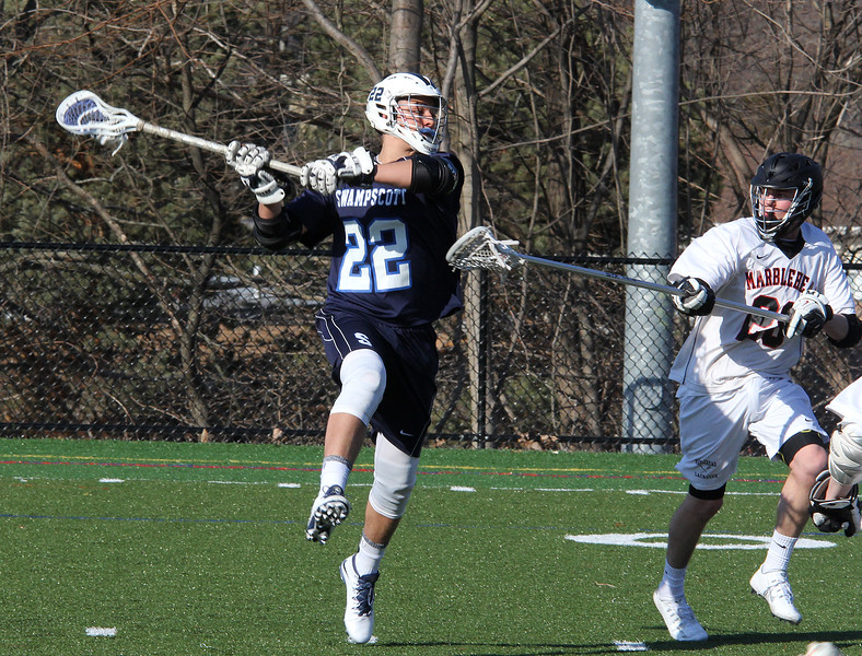 Sebastion Camelo, left, of Swampscott, takes a shot past Nate Wieherall in today's game.