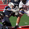 Jason Dignan of Swampscott, in the middle of a face off in their game against Marblehead today.