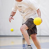 Tom Pierce dodges a ball while going on the attack during the dodgeball tournament at Swampscott High School on Wednesday, April 4. Item Photo / Angela Owens.