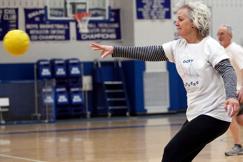 Laurie O'Brien whips a ball at the opposing team during the dodgeball tournament at Swampscott High School on Wednesday, April 4. Item Photo / Angela Owens.