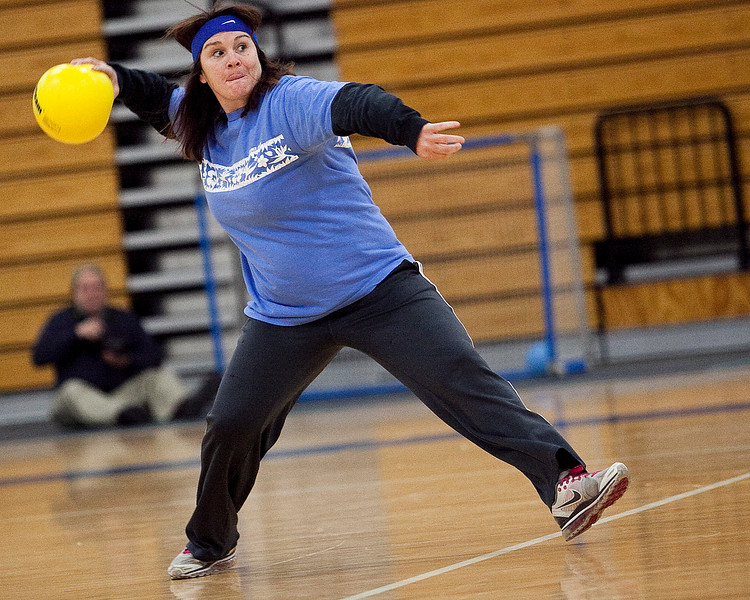 Gretchen McCullough whips a ball at her opponents during the dodgeball tournament at Swampscott High School on Wednesday, April 4. Item Photo / Angela Owens.