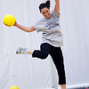 Anne Gold leaps to avoid a ball during the dodgeball tournament at Swampscott High School on Wednesday, April 4. Item Photo / Angela Owens.