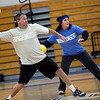 Lee Trentsch and Gretchen McCullough hurl the balls across the gym during the dodgeball tournament at Swampscott High School on Wednesday, April 4. Item Photo / Angela Owens.