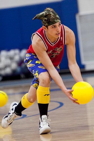 Steven Scaglione, 17, picks up a ball and hurls it across the gym during the dodgeball tournament at Swampscott High School on Wednesday, April 4. Item Photo / Angela Owens.