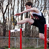 Marblehead's Mac O'Callaghan jumps over a hurdle during the track meet against Saugus on Wednesday, April 4. Item Photo / Angela Owens.