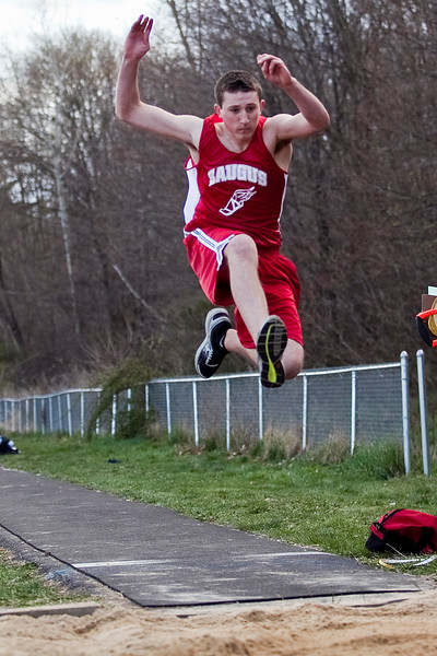 Atticus Anderchow competes in the long jump during the track meet against Marblehead on Wednesday, April 4. Item Photo / Angela Owens.