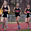 Marblehead's Lillie Johnston, Janaya Randall, and Molly Sweeney run the one-mile during the track meet against Saugus on Wednesday, April 4. Item Photo / Angela Owens.