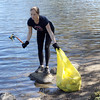 Sandra Lewis, the membership manager at the Lynn Area Chamber of Commerce, was one of the people helping clean Flax Pond and Flax Pond Park. Photo by Owen O'Rourke