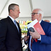 Lynn, Washington Street. Governor Charlie Baker announces $100 Million MassHousing Fund for Creation of Workforce Housing. Gov Baker talks with Tom O'Malley of the AFL-CIO Housing Investment Trust.