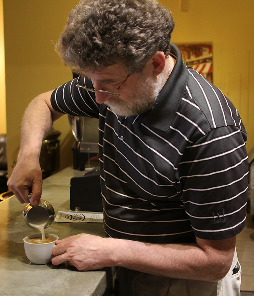 Yakov Tseitlin, the co-owner of Cafe Moka in Central Square, Lynn, making an expresso. Photo by Owen O'Rourke