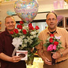 "David Daley, left, holding the ""Mother's Day Rose Package"" and Keith Saunders, right, holdling the ""Welch's Double the Love Trio Vase"" of Welch Florist on Essex Street in Lynn. Photo by Owen O'Rourke"