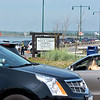 Nahant. Entrance to Nahant Beach Reservation. Saturday afternoon.  Officer Dave Driscoll controls traffic as cars wait in vain to enter the parking lot.  Lot full and many cars still in line to get in.
