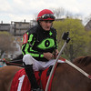 Vernon Bush won the opening race at Suffolk Downs dtokay riding a horse named Chasing Greg. Photo by Owen O'Rourke