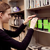 Kiely Quinn, 15, organizes the shelf of commercials for the TV production class annual auction at Swampscott High School on Tuesday, May 6. Item Photo / Angela Owens.