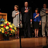 Jacqueline Lavin, St. Mary's class of 2014, left, singings the Nathional Anthem to help open the Lynn Catholic Schools partnership ceremony in Lynn Auditorium today. Also in photo are: Joanne Ford Eagan,Principal, Sacred Heart School, Grace Cotter Regan, St. Mary's Head of School, William Mosakowski, Jane Mosakowski, Michael Reardon, Catholic Schools Foundation, and James Walsh, Catholic School Office. Photo byOwen O'Rourke