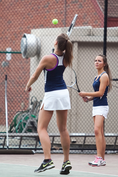 Lynnfield's Logan Colby-Nunziato returns a volley, while competing in doubles with her sister Sloan Colby-Nunziato, during their match at Lexington High School on Monday, June 9. Item Photo / Angela Owens.