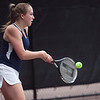 Lynnfield's Kelley Nevils returns a volley during their match at Lexington High School on Monday, June 9. Item Photo / Angela Owens.