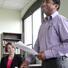 Attorney General Maura Healey listens to Mani Biswa, a former student, now a case manage at the New American Center in Lynn, deliver a speech during her tour of the  Center today. Photo by Owen O'Roruke