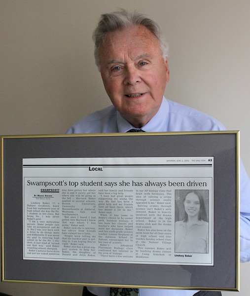 Don Baker with a picture of her daughter Lindsey who is now a doctor researching a treatment for pancreatic cancer. Photo by Owen O'Rourke
