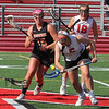 Marblehead's Lucie Poulin gets the ball on the face off from Ellie Swenson of Ipswich in their game against Ipswich. Photo by Owen O'Rourke