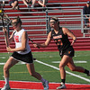 Caroline Driscoll of Marblehead gets the ball from Jordan Morrissey on the face-off.