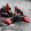 Lynn Fire Captain Dan Lozzi, left, Lynn Fire Figthter Joe Comeau, middle, and Lynn Fire Fighter Justin Murray, right, testing the 12 foot inflatable on Sluice Pond in Lynn today. Photo by Owen O'Rourke