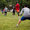Ble Ley, 15, stands in a make-shift goal between two barrels while playing soccer on the Lynn Common on Thursday, June 12. Item Photo / Angela Owens.