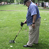 Larry Kadra, of Lynn, has been serching for metal with a metal detector for 49 years now, much of it on Lynn Common. Photo by Owen O'Rourke