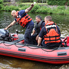 Lynn Fire Fighter Jusdtin Murray, left, starting the moter on the 12 foot inflatable before taking it out on Sluice Pond in Lynn with Fire Captain Dan Lozzi, middle, and Fire Fighter Joe Comeau. Photo by Owen O'Rourke
