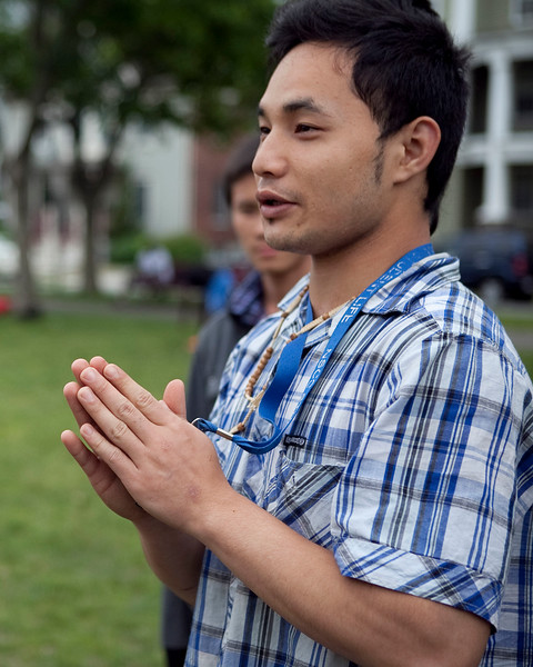 Saw Shin, 20, talks about the World Cup before playing soccer on the Lynn Common on Thursday, June 12. Item Photo / Angela Owens.