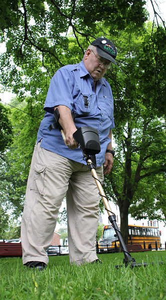 Larry Kadra searches for metal on Lynn Common. Photo by Owen O'Rourke