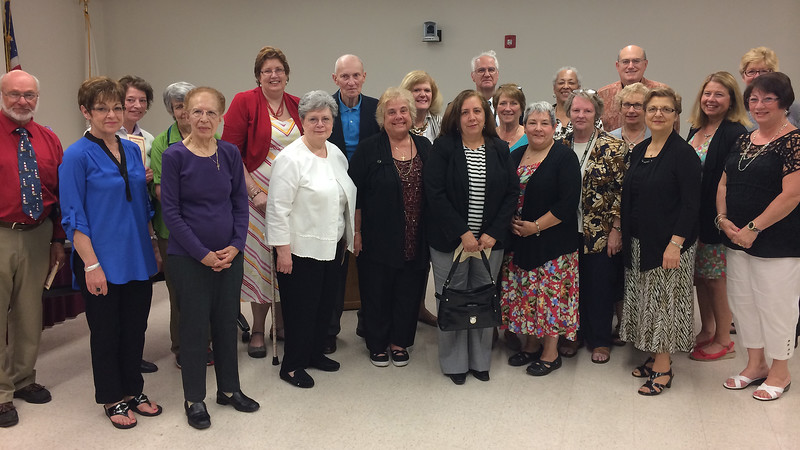 Retiring teachers pose for a photo at the school administration building on Thursday, June 12. Item Photo / Angela Owens.