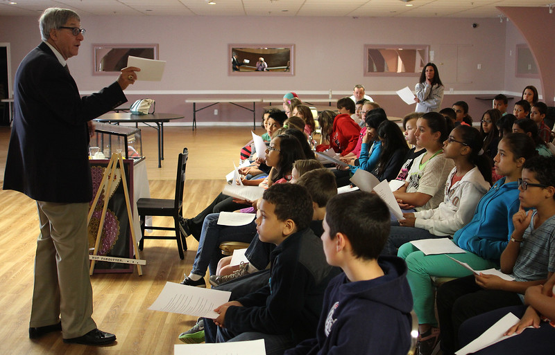 Prior to visiting The Wall That Heals now at the Bennington VFW Post 6712 in Revere, fifth grade students from the Beachmont Veterans Memorial School in Revere get a lesson in Vietnamese history from retired school teacher Jeff Pearlman. Photo by Owen O'Rourke