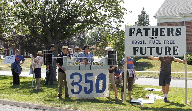 The 350 group displaying signs across from Governor Baker's house.