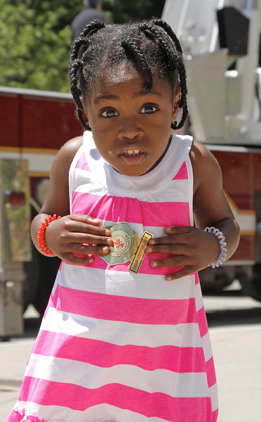 Emily Bryson shows off her special firefighters badge.