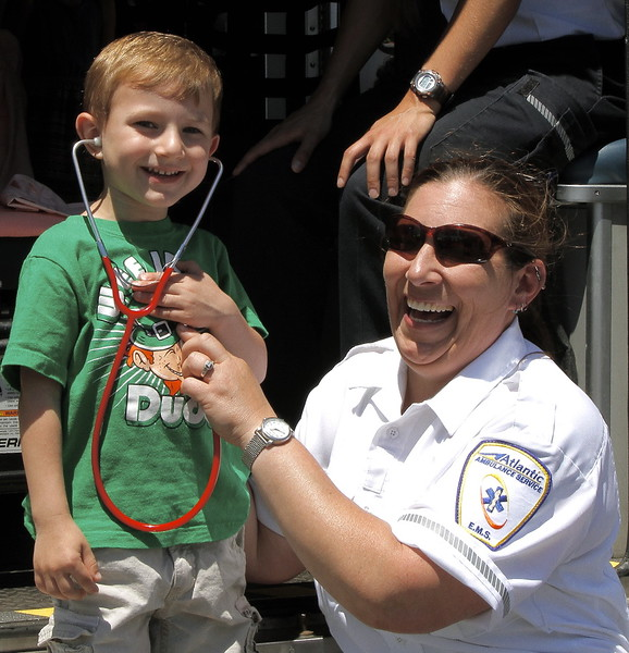 Three year old Dylan O'Connell has his heartbeat checked by Cindy Tarantino of Atlantic Ambulance.
